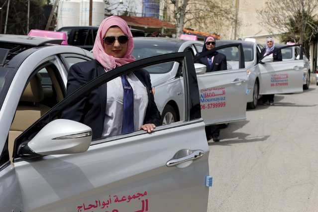Female taxi drivers pose for a photo in front of their vehicles at Noor Jordan for Transport – Taxi Moumayaz's (Special Taxi) parking lot in Amman, Jordan, March 24, 2016. The Jordanian taxi company has launched a new service run only for women, exclusively by women. These three female drivers are among 10 women taxi drivers who will be working as taxi drivers for the first time in Jordan, picking up only female passengers and families. The company chairman Abu al-Haj said they plan to hire another 10 women as drivers, and possibly more if the service expands. (Photo by Muhammad Hamed/Reuters)
