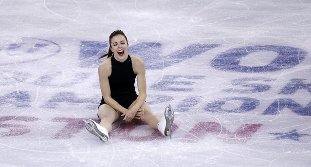 Ashley Wagner, of the United States, laughs after falling to the ice, after thanking the crowd and taking a bow, during the women's short program in the World Figure Skating Championships, Wednesday, March 31, 2016, in Boston. (Photo by Elise Amendola/AP Photo)