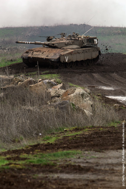 An Israeli army tank advances in support of paratroopers as their brigade completes a week-long live-fire training exercise