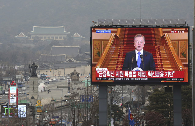 """A TV screen shows the live broadcast of South Korean President Moon Jae-in's press conference in Seoul, South Korea, Thursday, January 10, 2019. Moon has suggested he'll push for sanction exemptions to restart dormant economic cooperation projects with North Korea. The signs read """"Finance Innovation"""". (Photo by Ahn Young-joon/AP Photo)"""