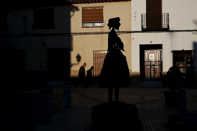 A man walks past a statue of Don Quixote's ladyship Dulcinea in her hometown of El Toboso, Spain, April 7, 2016. (Photo by Susana Vera/Reuters)