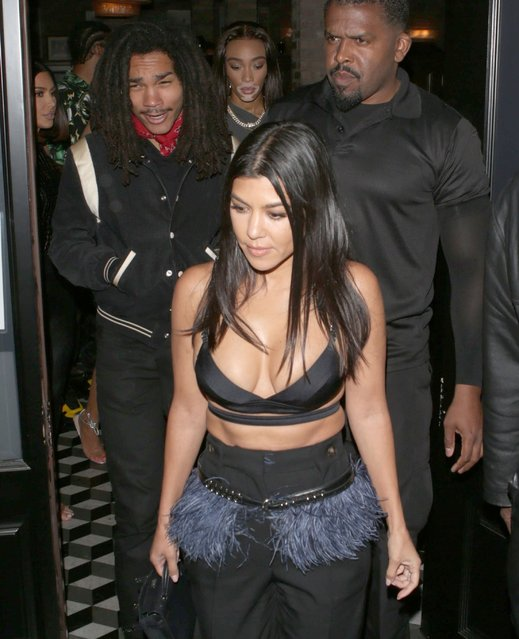 Kourtney Kardashian proudly showcases her cleavage during a night out with on/off fling Luka Sabbat, model Winnie Harlow, sister Kim Kardashian and her hubby Kanye West Wednesday, July 10, 2019. (Photo by X17/SIPA Press)