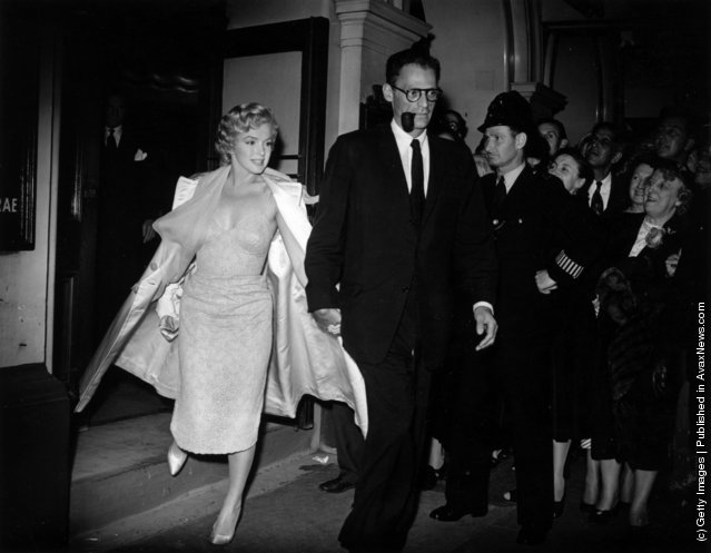 1956: American film actress Marilyn Monroe (1926 - 1962) leaving the Lyric Theatre in London with her third husband American dramatist Arthur Miller