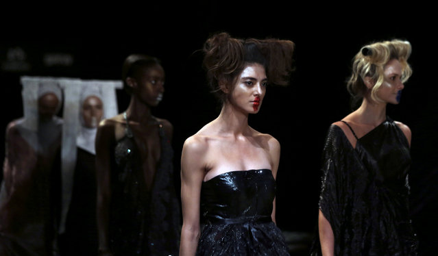 Models present creations from the Lino Villaventura collection during Sao Paulo Fashion Week in Sao Paulo, Brazil, April 29, 2016. (Photo by Paulo Whitaker/Reuters)