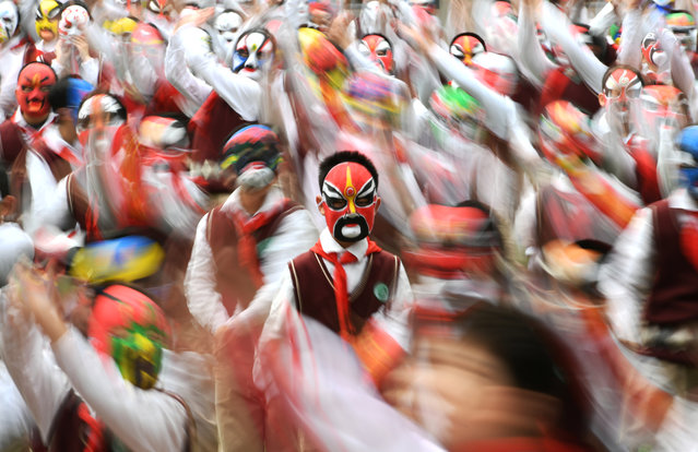 Students wearing traditional opera masks attend an exercise session in Wuhan, Hubei province, China March 28, 2017. (Photo by Reuters/Stringer)