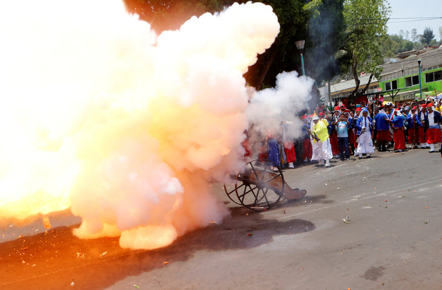 Mexicans wearing period costumes, fire a cannon during a re-enactment of the battle of Puebla in the Penon de los Banos neighbourhood of Mexico City, Mexico, May 5, 2016. (Photo by Henry Romero/Reuters)