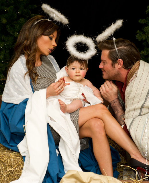 Posh & Becks look-a-likes create a nativity scene during the launch of the Alison Jackson book 'Exposed - The Pictures The Celebs Didn't Want You To See 2011
