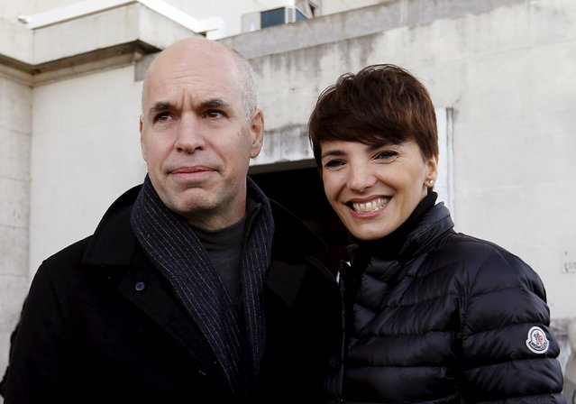 Candidate Horacio Rodriguez Larreta of the PRO party poses alongside his wife Barbara after voting in an election for Buenos Aires' City Mayor in Buenos Aires, Argentina, July 5, 2015. The centre-right opposition in Argentina is looking to gain a boost Sunday in the mayoral elections in Buenos Aires city ahead of presidential elections later in the year. (Photo by Enrique Marcarian/Reuters)