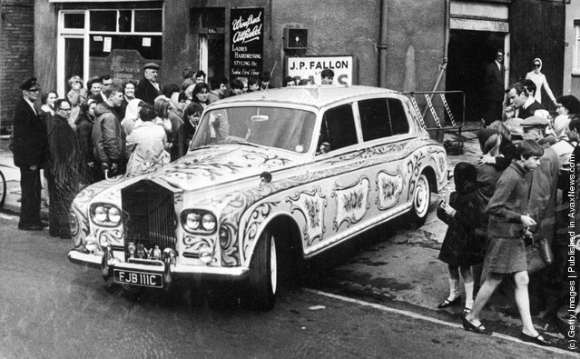 1967: Beatle John Lennon's Rolls Royce, decorated with signs of the zodiac and bunches of flowers, in Chertsey, Surrey