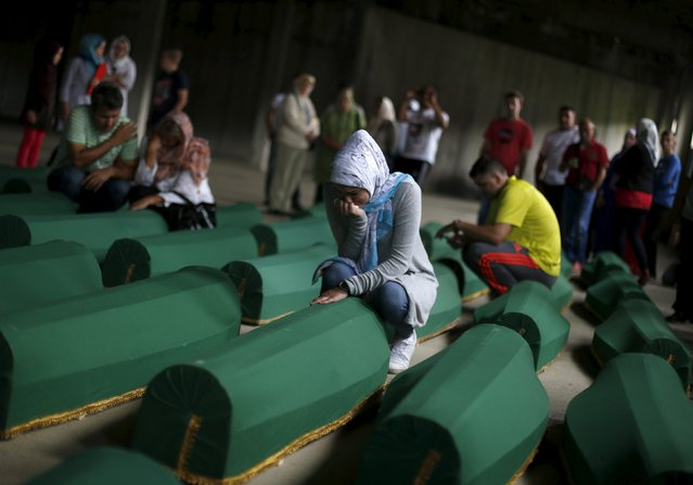 A woman cries near a coffin containing the body of a newly identified victim of the 1995 Srebrenica massacre, at the Memorial Center in Potocari near Srebrenica, Bosnia and Herzegovina, July 9, 2015. The bodies of the 136 recently identified victims of Srebrenica massacre will be buried on July 11, the anniversary of the massacre when Bosnian Serb forces slaughtered 8,000 Muslim men and boys and buried them in mass graves in Europe's worst massacre since World War Two. (Photo by Stoyan Nenov/Reuters)