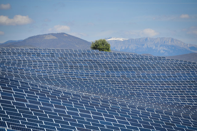 A view shows photovoltaic solar pannels at the power plant in La Colle des Mees, Alpes de Haute Provence, southeastern France, on April 17, 2019. The 112,000 solar panels cover an area of 200 hectares with a total capacity of 100MW. (Photo by Gerard Julien/AFP Photo)