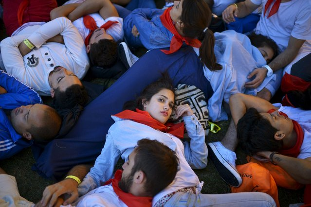 Revellers sleep it off at the Plaza del Castillo on the seventh day of the San Fermin festival in Pamplona, northern Spain, July 12, 2015. (Photo by Vincent West/Reuters)