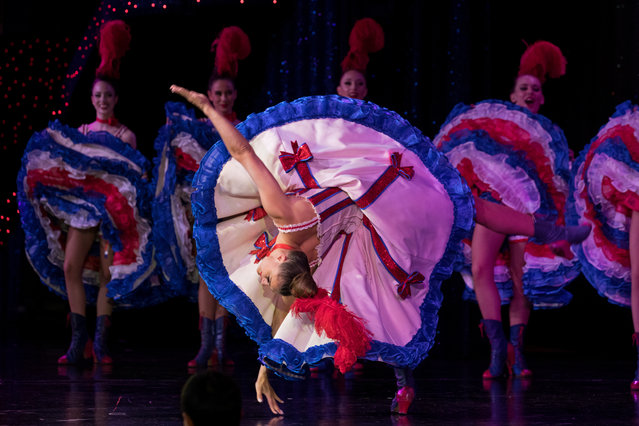 """French Cancan soloist Olga Khokhlova, a dancer from ex-Soviet Kazakhstan, performs at the Moulin Rouge in Paris, France, July 4, 2018. Khokhlova has been at the Moulin Rouge for 12 years. """"I love the adrenaline of the stage. The Moulin is a magical place where I live out my passion"""" she said. """"When I'm on stage, I know that I am the inheritor of famous dancers who for 130 years have made the Moulin Rouge"""". (Photo by Philippe Wojazer/Reuters)"""