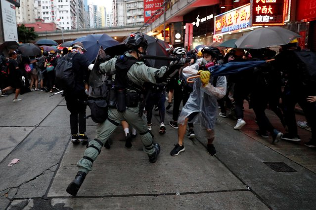 A riot police officer clashes with a protester during an anti-government rally in central Hong Kong, China on October 6, 2019. (Photo by Jorge Silva/Reuters)