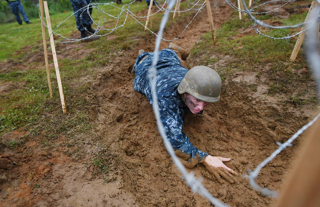 United States Naval Academy plebe, Jon Pyzdrowski crawls through mud as he takes part in Sea Trials at the United States Naval Academy on Tuesday May 17, 2016 in Annapolis, MD. (Photo by Matt McClain/The Washington Post)