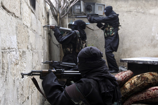 Women, who are part of the Sawt al-Haq (Voice of Rights), take aim with their weapons as they undergo military training in Aleppo February 17, 2013. (Photo by Muzaffar Salman/Reuters)