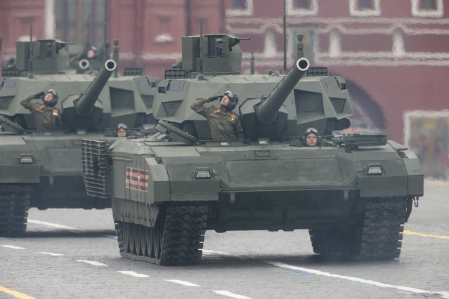 Russian soldiers drive military vehicles along Red Square during the Victory Day military parade to celebrate 72 years since the end of WWII and the defeat of Nazi Germany, in Moscow, Russia, on Tuesday, May 9, 2017. (Photo by Ivan Sekretarev/AP Photo)