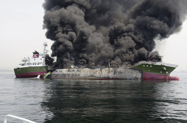 Smoke rises from the 998-ton fuel tanker Shoko Maru after it exploded off the coast of Himeji, western Japan, on May 29, 2014. The fuel tanker captain is missing and four crew members sustained severe injuries following the explosion aboard the vessel, Kyodo news reported. (Reuters/5th Regional Coast Guard Headquarters - Japan Coast Guard)
