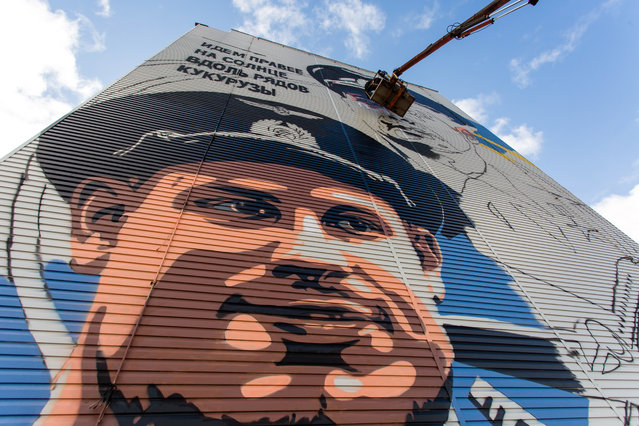 Artists of Samara's ArtWay studio paint a mural depicting the Ural Airlines' pilots Damir Yusupov and Georgy Murzin who landed an Airbus A321 plane in a cornfield on August 15, 2019 in Surgut, Russia on September 11, 2019. (Photo by Alexei Andronov/TASS)
