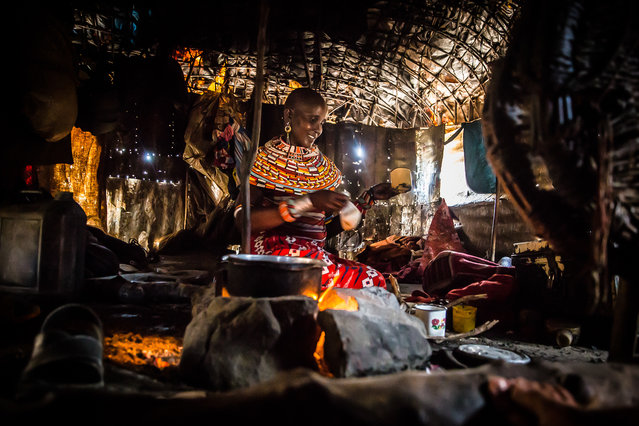 """""""A Beaded Woman"""". A young Samburu woman prepares tea for visitors. Photo location: Isiolo, Kenya. (Photo and caption by Ralph Pace/National Geographic Photo Contest)"""
