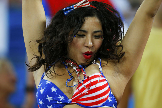 A U.S. fan dances before the 2014 World Cup Group G soccer match between Ghana and the U.S. at the Dunas arena in Natal June 16, 2014. (Photo by Brian Snyder/Reuters)