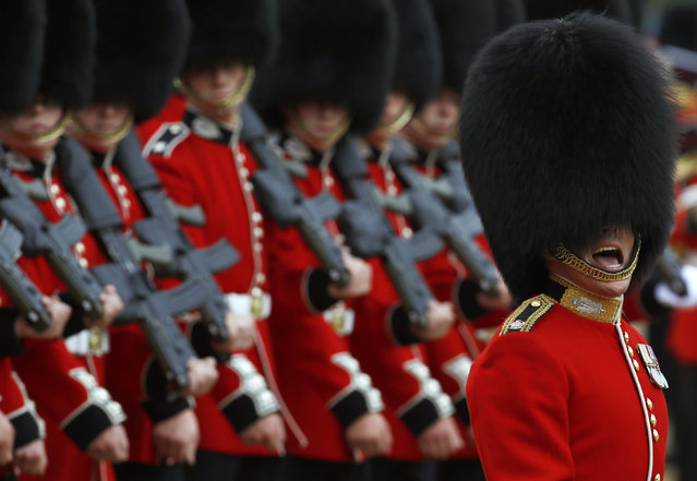 Guardsmen of the Scots Guards parade during the Trooping the Colour ceremony at Horse Guards Parade in London June 14, 2014.  Trooping the Colour is a ceremony to honor the Queen's official birthday. (Photo by Luke MacGregor/Reuters)