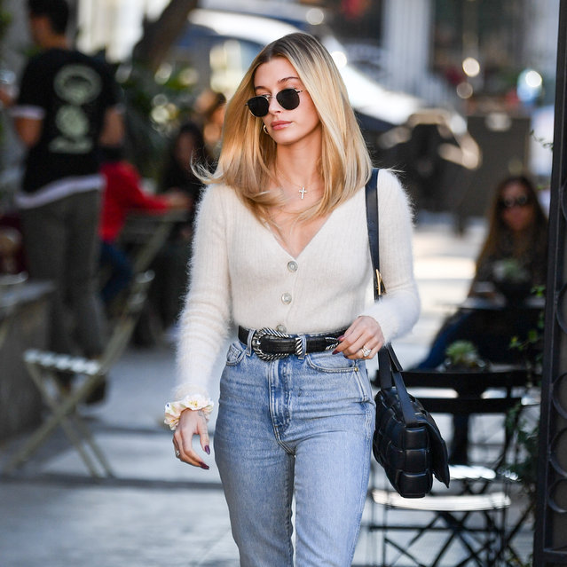 Hailey Bieber is seen leaving Nine Zero One salon on melrose place in Los Angeles on December 19, 2019. The fashion trend setter wore denim jean pair with a cozy looking tan top and heels. (Photo by PG/RACHPOOT/The Mega Agency)