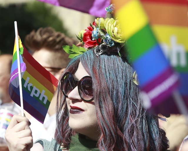 Warsaw resident with rainbow flags walk in a colorful annual Equality Parade to show their support for sexual minority groups  in Warsaw, Poland, Saturday, June 11, 2016. (Photo by Czarek Sokolowski/AP Photo)
