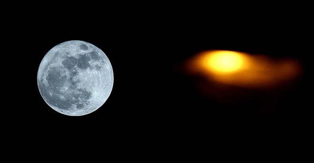 The full perigee moon rises over Namur, Belgium