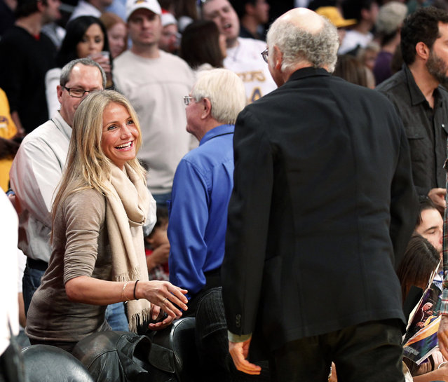 Cameron Diaz talks with Larry David before the Heat play the Lakers in Los Angeles, December 2010. (Photo by Danny Moloshok/Reuters)