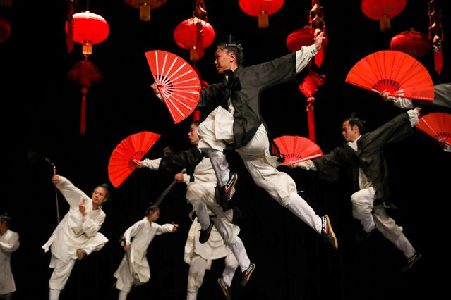 Chinese Wudang wushu group members perform a traditional Kung Fu show to celebrate the Chinese spring festival at the Royal Cultural Centre in Amman, Jordan on January 20, 2020. (Photo by Muhammad Hamed/Reuters)