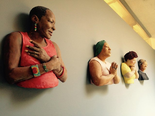 "This July 31, 2015 photo shows an exhibit installed by No Longer Empty (NLE) in New York, showing bronze sculptures of women on the wall  titled ""Ernestine and Three Friends"" by John Ahearn, which recently hung in a women's shelter. They are part of a current show ""Bring in the Reality"", for the Nathan Cummings Foundation that reflects the foundation's focus on social and economic justice. (Photo by Ula Ilnytzky/AP Photo)"