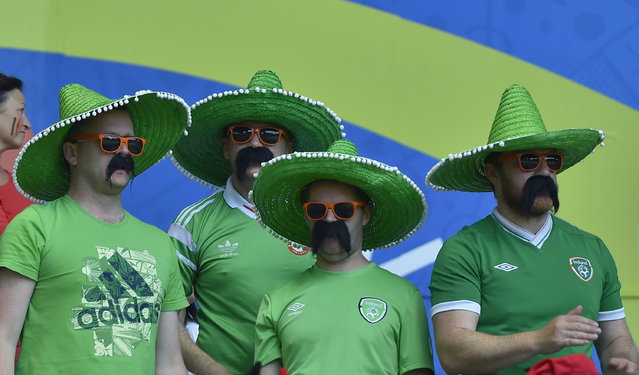 Ireland supporters attend the Euro 2016 group E football match between Belgium and Ireland at the Matmut Atlantique stadium in Bordeaux on June 18, 2016. (Photo by Loic Venance/AFP Photo)