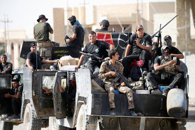 Iraqi counterterrorism forces gather in Falluja, Iraq, June 26, 2016. (Photo by Thaier Al-Sudani/Reuters)