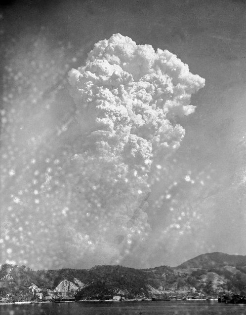 In this August 6, 1945, file photo, smoke rises 20,000 feet above Hiroshima, Japan, after the first atomic bomb was dropped. On two days in August 1945, U.S. planes dropped two atomic bombs, one on Hiroshima, one on Nagasaki, the first and only time nuclear weapons have been used. Their destructive power was unprecedented, incinerating buildings and people, and leaving lifelong scars on survivors, not just physical but also psychological, and on the cities themselves. Days later, World War II was over. (Photo by AP Photo)