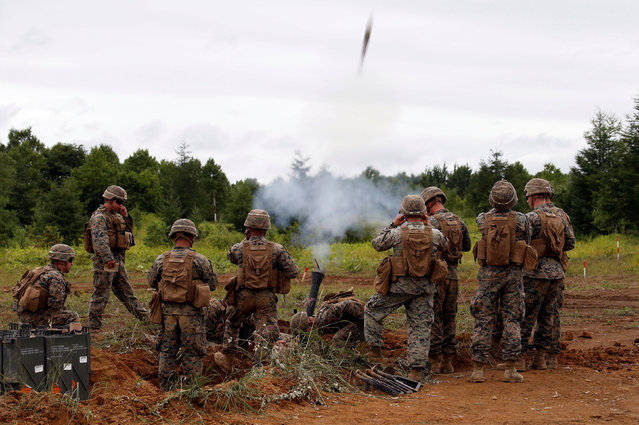 U.S. Marine Corps' members launch a mortar during a joint exercise with Japan's Ground Self Defense Force, named Northern Viper 17 at Hokudaien exercise area in Eniwa, on the northern island of Hokkaido, Japan August 14, 2017. (Photo by Toru Hanai/Reuters)