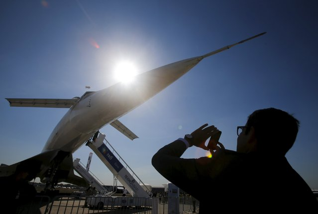 A visitor takes a picture of a Tupolev Tu-144 commercial supersonic transport aircraft on display at the MAKS International Aviation and Space Salon in Zhukovsky, outside Moscow, Russia, August 25, 2015. (Photo by Maxim Shemetov/Reuters)