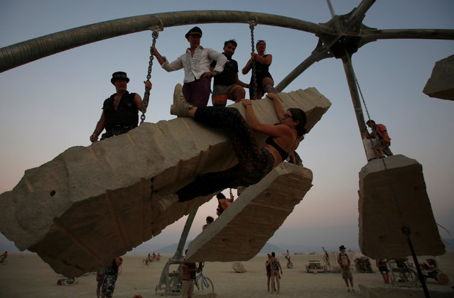 Esterline climbs on the Temple of Gravity as approximately 70,000 people from all over the world gathered for the annual Burning Man arts and music festival in the Black Rock Desert of Nevada, U.S. on September 1, 2017. (Photo by Jim Urquhart/Reuters)