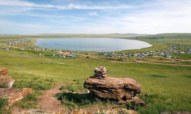 A general view shows a tourist camp on the banks of lake Tus in Khakassia region, southwest of the Siberian city of Krasnoyarsk, Russia, July 16, 2016. (Photo by Ilya Naymushin/Reuters)