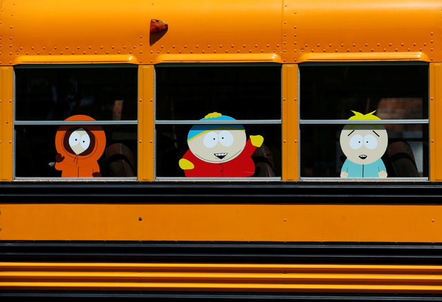"""Characters from the television show """"South Park"""" appear on the windows of a school bus outside the convention center hosting Comic-Con International in San Diego, California, United States, July 20, 2016. (Photo by Mike Blake/Reuters)"""