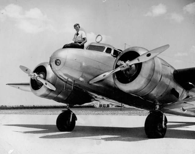 This 1937 photo shows Amelia Earhart before takeoff in Miami for an attempted round-the-world flight. Earhart and her navigator, Fred Noonan, disappeared in the South Pacific in July 1937, while on one of the last legs of that journey. (Photo by The Miami Herald via AP Photo)
