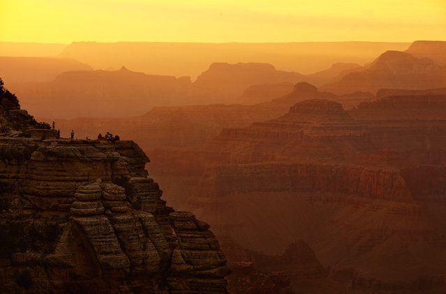 Grand Canyon at Dusk: Grand Canyon visitors watch the sunset from a perch on the south side. (Photo by Phil Hawkins/National Geographic Photo Contest
