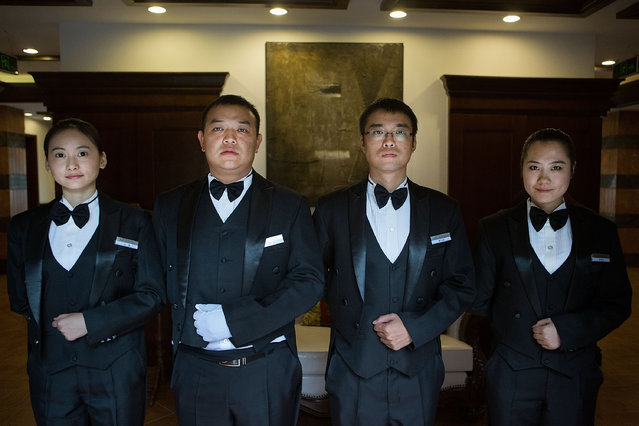 Butlery students stand for a portrait at The International Butler Academy China on September 16, 2014 in Chengdu, China. (Photo by Taylor Weidman/Getty Images)