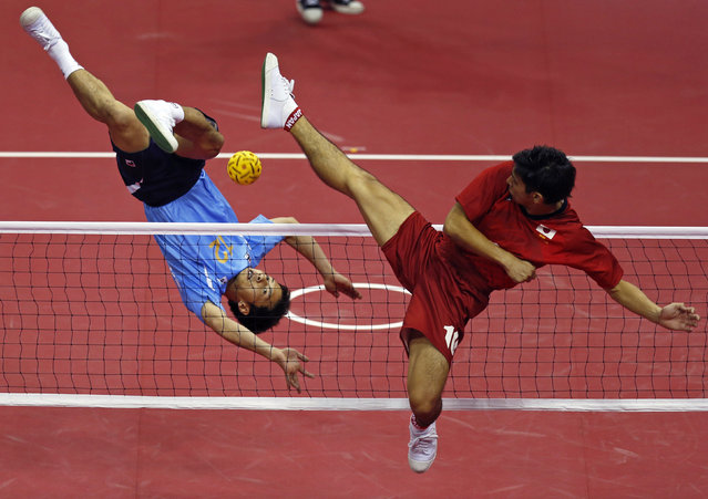 South Korea's Hong Seung-hyun (L) strikes the ball against Japan's Toshitaka Naito during their men's team sepaktakraw game at the Bucheon Gymnasium during the 17th Asian Games in Incheon September 24, 2014. (Photo by Issei Kato/Reuters)