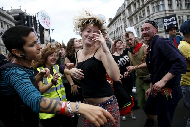 A protester dances during a demonstration to express solidarity with migrants and to demand the government welcome refugees into Britain, in London, September 12, 2015. (Photo by Stefan Wermuth/Reuters)