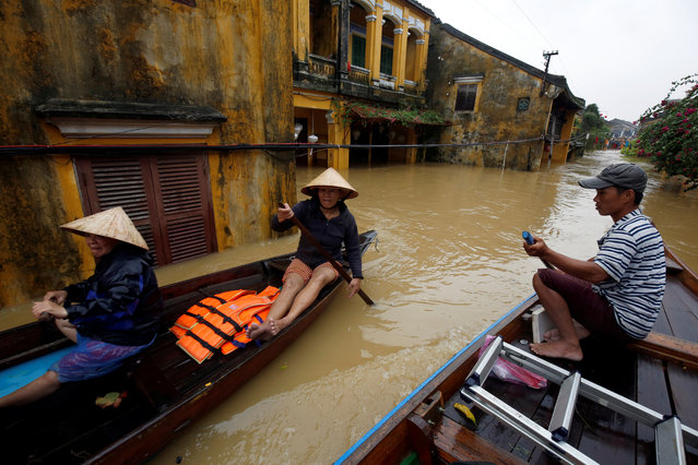 People ride a boat along submerged houses in UNESCO heritage ancient town of Hoi An after typhoon Damrey hits Vietnam on November 6, 2017. (Photo by Reuters/Kham)