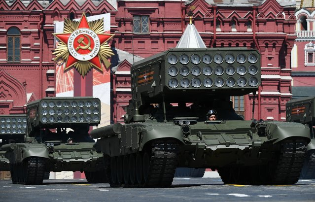 Russian TOS-1A multiple rocket launchers drive during the Victory Day Parade in Red Square in Moscow, Russia, June 24, 2020. (Photo by Ramil Sitdikov/Host Photo Agency via Reuters)