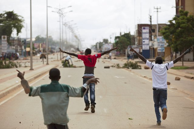 Anti-coup protesters gesture on a road in Ouagadougou, Burkina Faso, September 18, 2015. (Photo by Joe Penney/Reuters)
