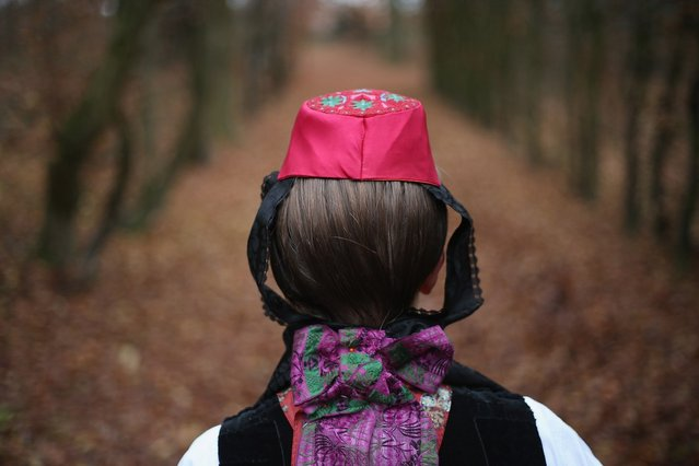 Little Red Riding Hood (in German: Rotkaeppchen, which translates to Little Red Cap), actually actress Dorothee Weppler, wears the local Schwalm region folk dress with its red cap as she walks through a forest on the estate of Baron von Schwaerzel on November 20, 2012 in Willingshausen, Germany. Little Red Riding Hood is one of the many stories featured in the collection of fairy tales collected by the Grimm brothers, and the two reportedly first came across the story while staying on the von Schwaerzel estate. The 200th anniversary of the first publication of Grimms' Fairy Tales will take place this coming December 20th. The Grimm brothers collected their stories from oral traditions in the region between Frankfurt and Bremen in the early 19th century, and the works include such global classics as Sleeping Beauty, Rapunzel, The Pied Piper of Hamelin, Cinderella and Hansel and Gretel.  (Photo by Sean Gallup)