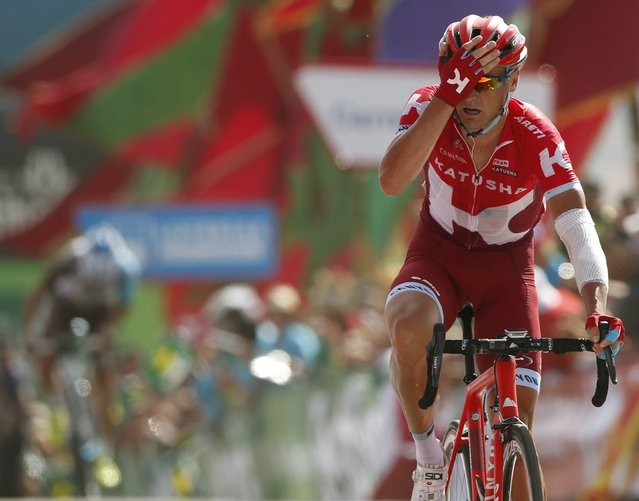 Russian Sergey Lagutin of Katusha celebrates his victory in the 8th stage of the Spanish Vuelta, a 181,5 km race between Villalpando and La Camperona, in Spain on 27 August 2016. (Photo by Javier Lizon/EPA)